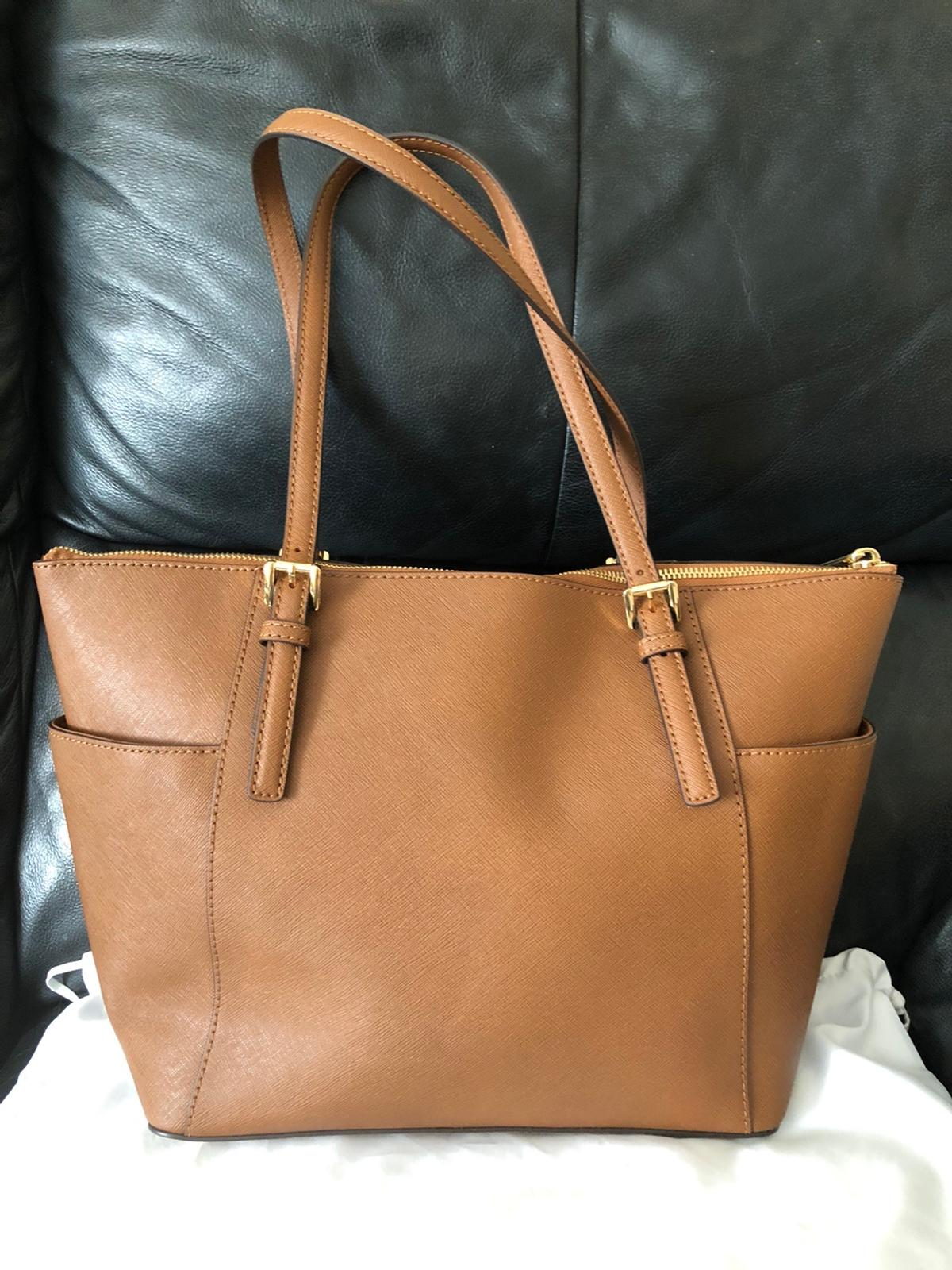NO OFFERS ACCEPTED Brand-new bag still tagged Michael kors jet set saffiano leather top zip tote bag authentic from Michael kors store.My husband got me this a few years ago but it's just been left in the cupboard hence sale (You can look on line for future details) Paid £220 still currently in store for £225 W-15 H=10 D=4.5 inches Collection b712je Post extra £5