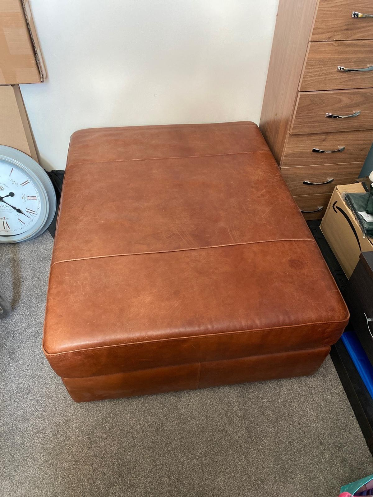 Large leather footrest, no room in house for it since moving, some scratchers from pet on top as she used to like to sleep on it. Smoke free home.