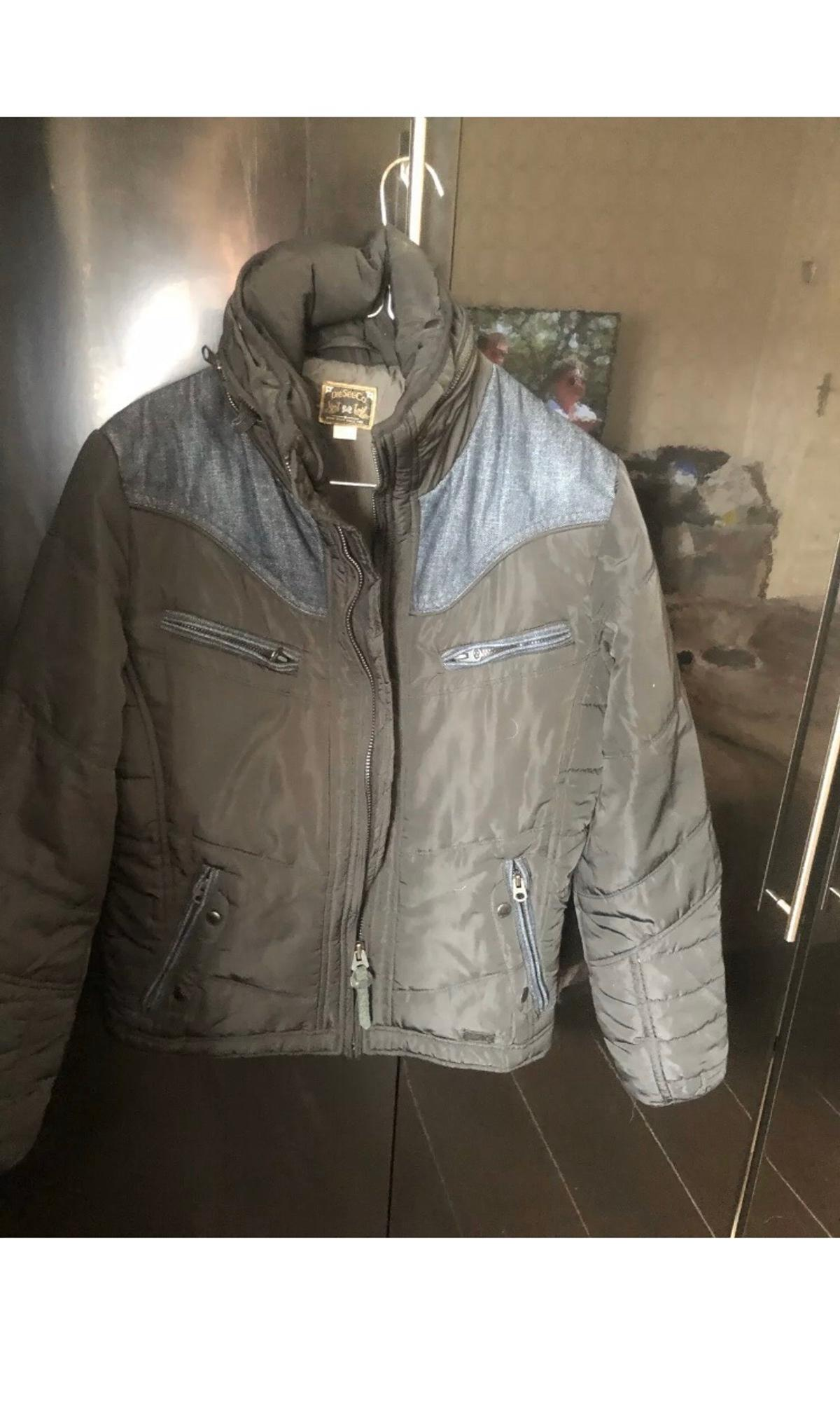 Diesel Coat Teflon.Black With Denim Trim and fold away hood Small Size in very good condition