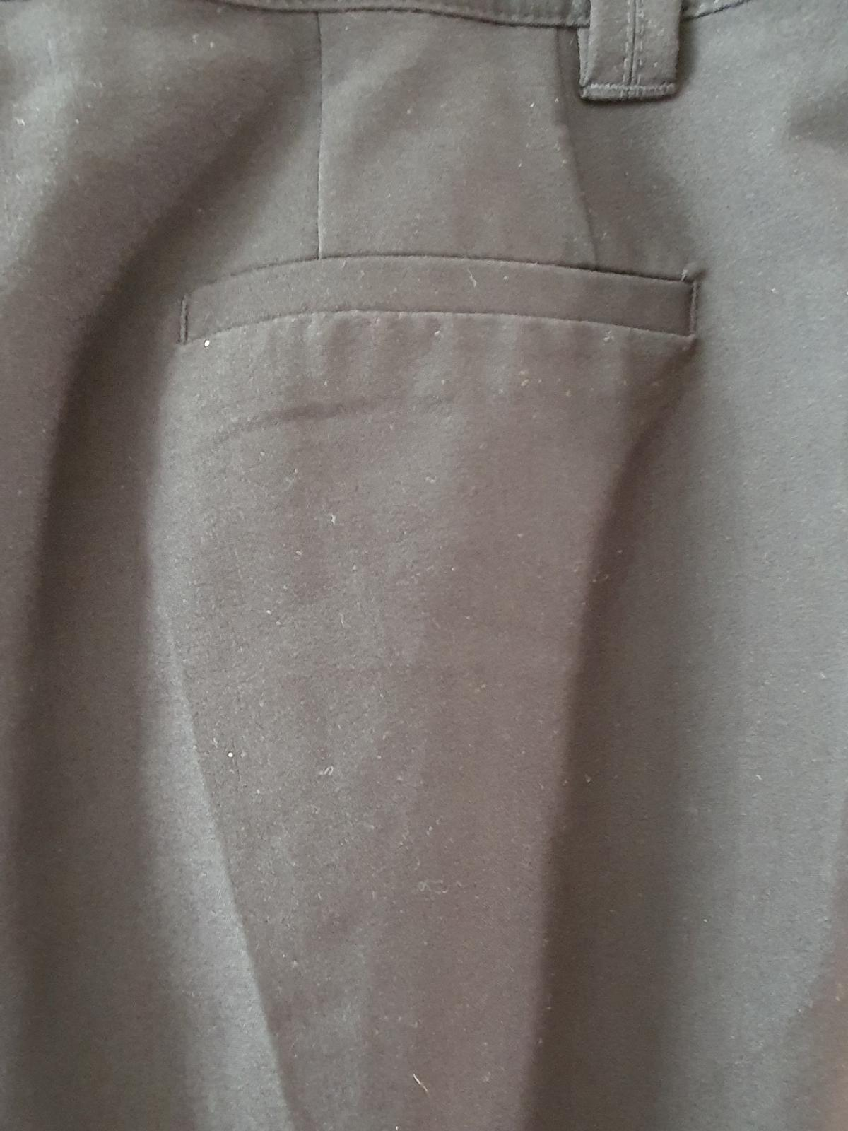 Next longer length black shorts with zip fastening front and belt loops, size 16. cash and collection only from a safe distance from Hexthorpe near the park.