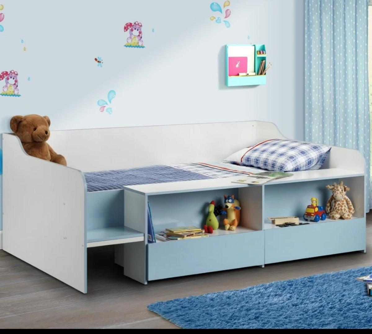 Superbly suited to snug spaces, the Stella Blue and White Wooden Kids Low Sleeper Cabin Storage Bed comes complete with two concise storage spaces for small things like toys and books. Both of these spaces are situated below a long lip that extends down most of the beds length, which could easily serve as an extended bedside table. Easy Assembly and in very good condition . MATTRESS also included