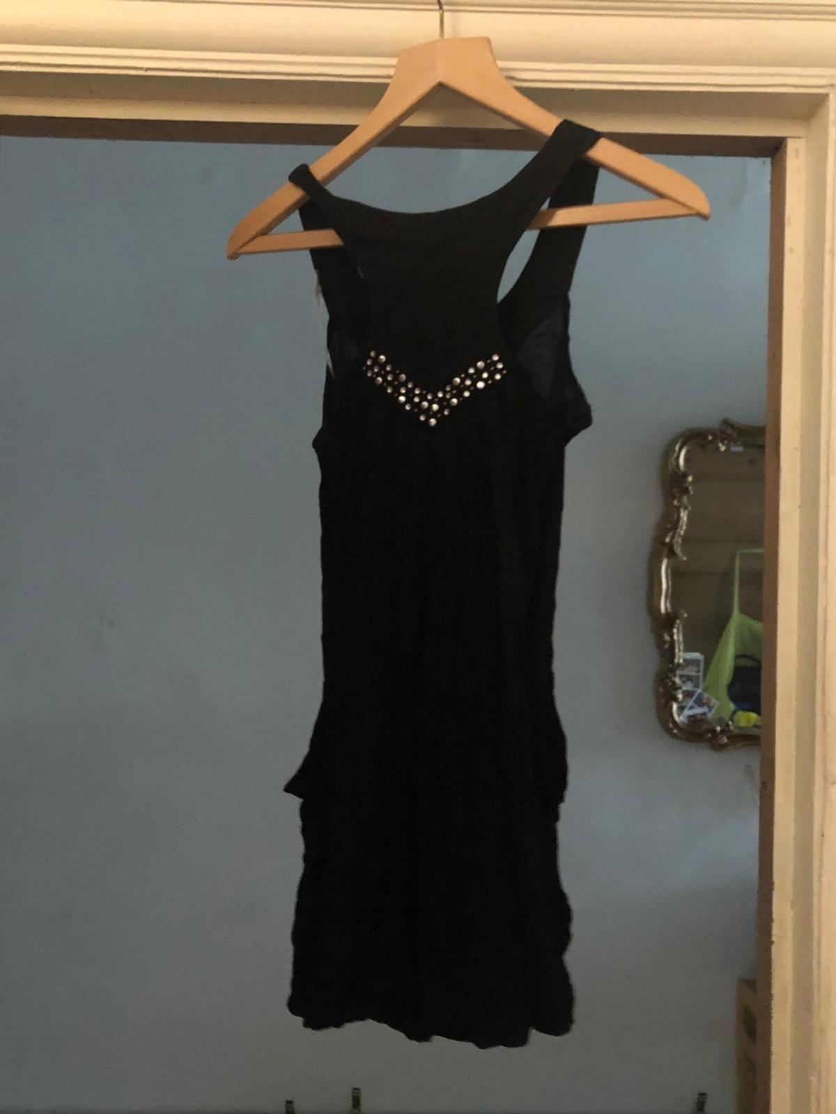 New black top, size 10 Can collect from London Nw10 or would deliver by Hermes