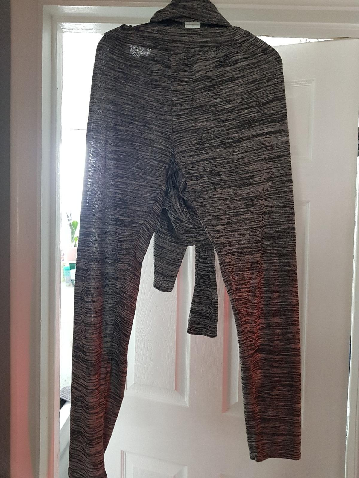grey track suit with black bows large/ from lily