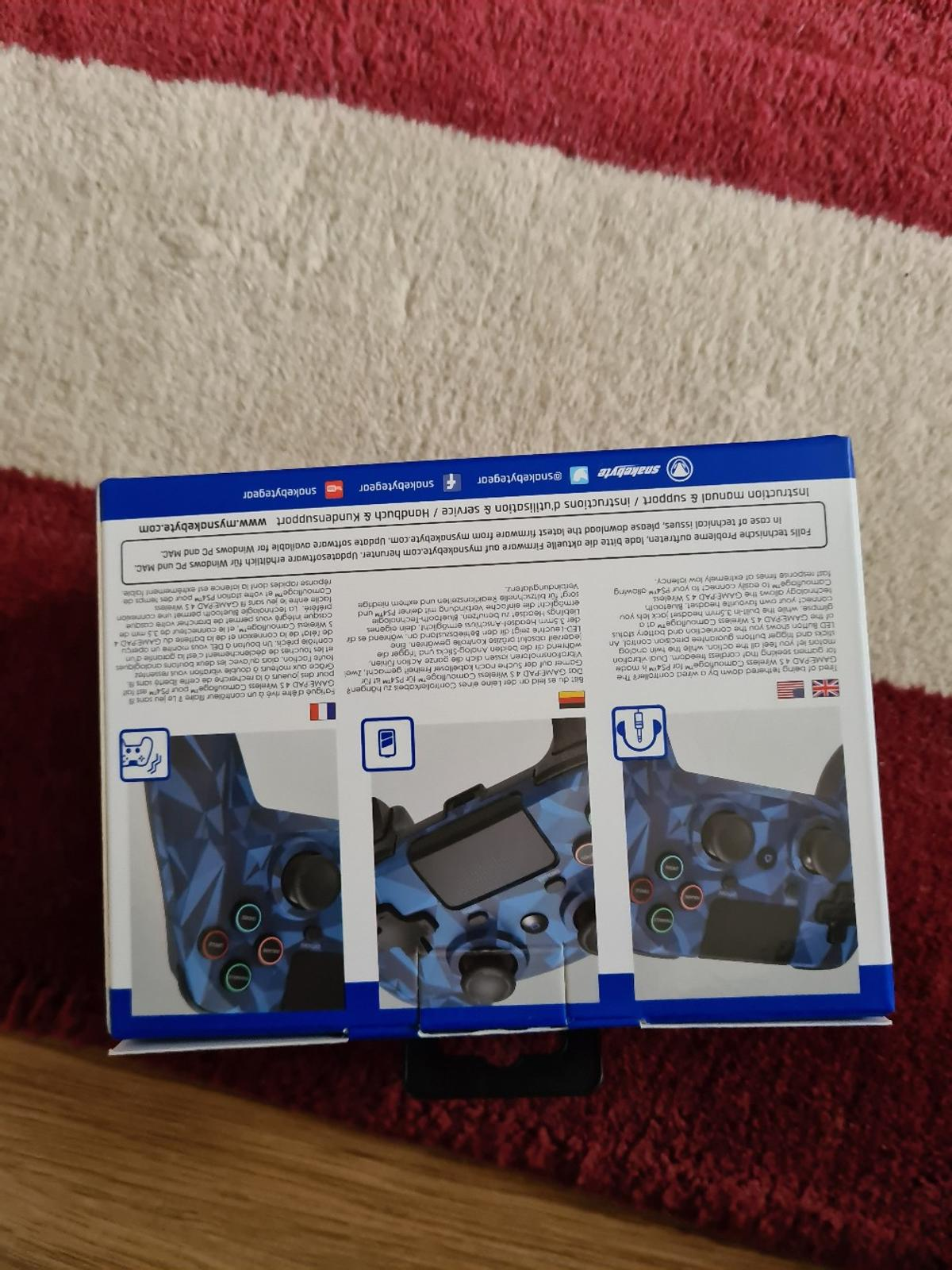used only once - wireless camouflage, Blue game pad 4S purchased from Argos.  suitable for a PS4 Slim and Pro.  £35 brand new.