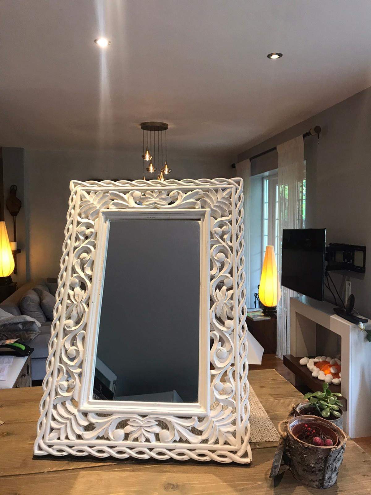 A brand new mirror, with a white ,wooden frame that could also be used as a picture frame. The mirror also has a stand at the back. Dimension:  Frame Height-65 Width-45  Mirror Height-43 Width-24cm