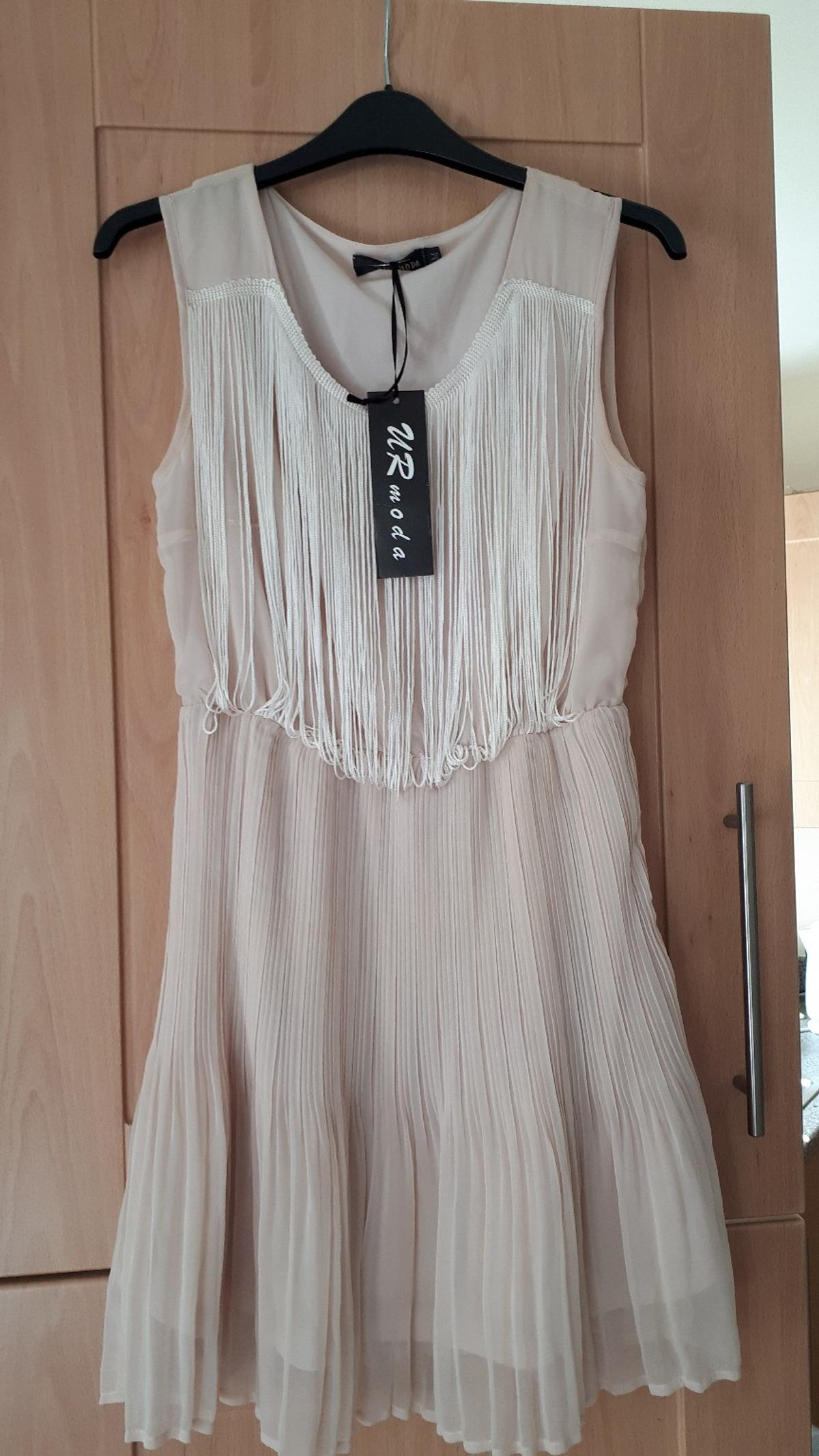 Brand new, never worn, tags still on,
