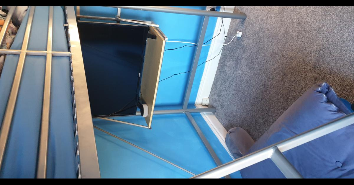 A high sleeper with sitting area underneath. Seat/pull out bed included and also a shelf. The shelf has been slightly modified to accommodate the TV. This bed is in good condition.