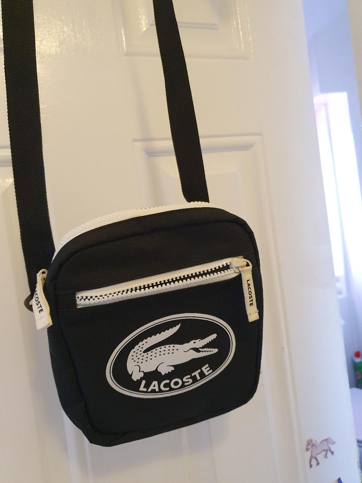 LACOSTE BAG NEW ANY QUESTIONS PLEASE ASK SORRY I DONT POST COLLECTION ONLY!