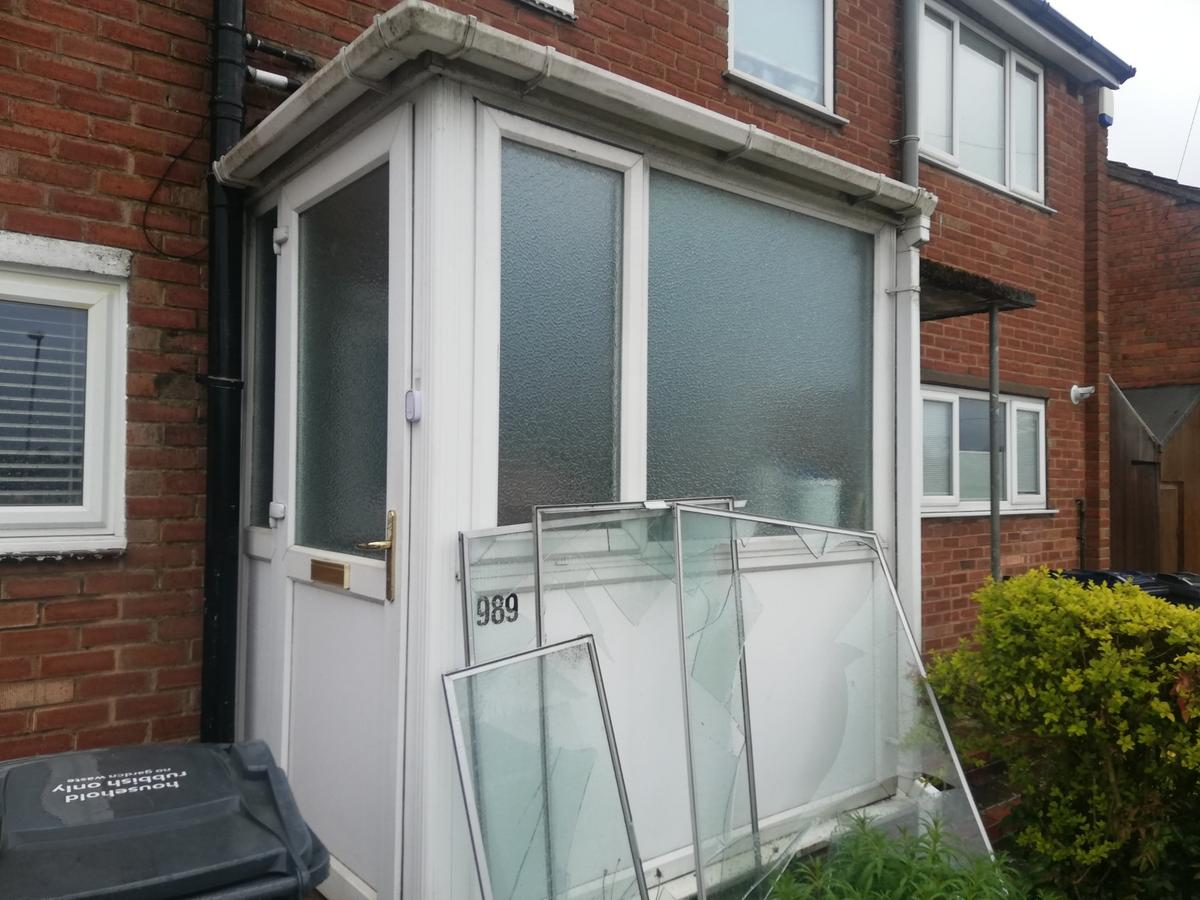 right hand door from house is wider for disability access one window which opens back panel only half width as shown in picture would need to dismantle roof could potentially be salavaged if you know what you are doing.