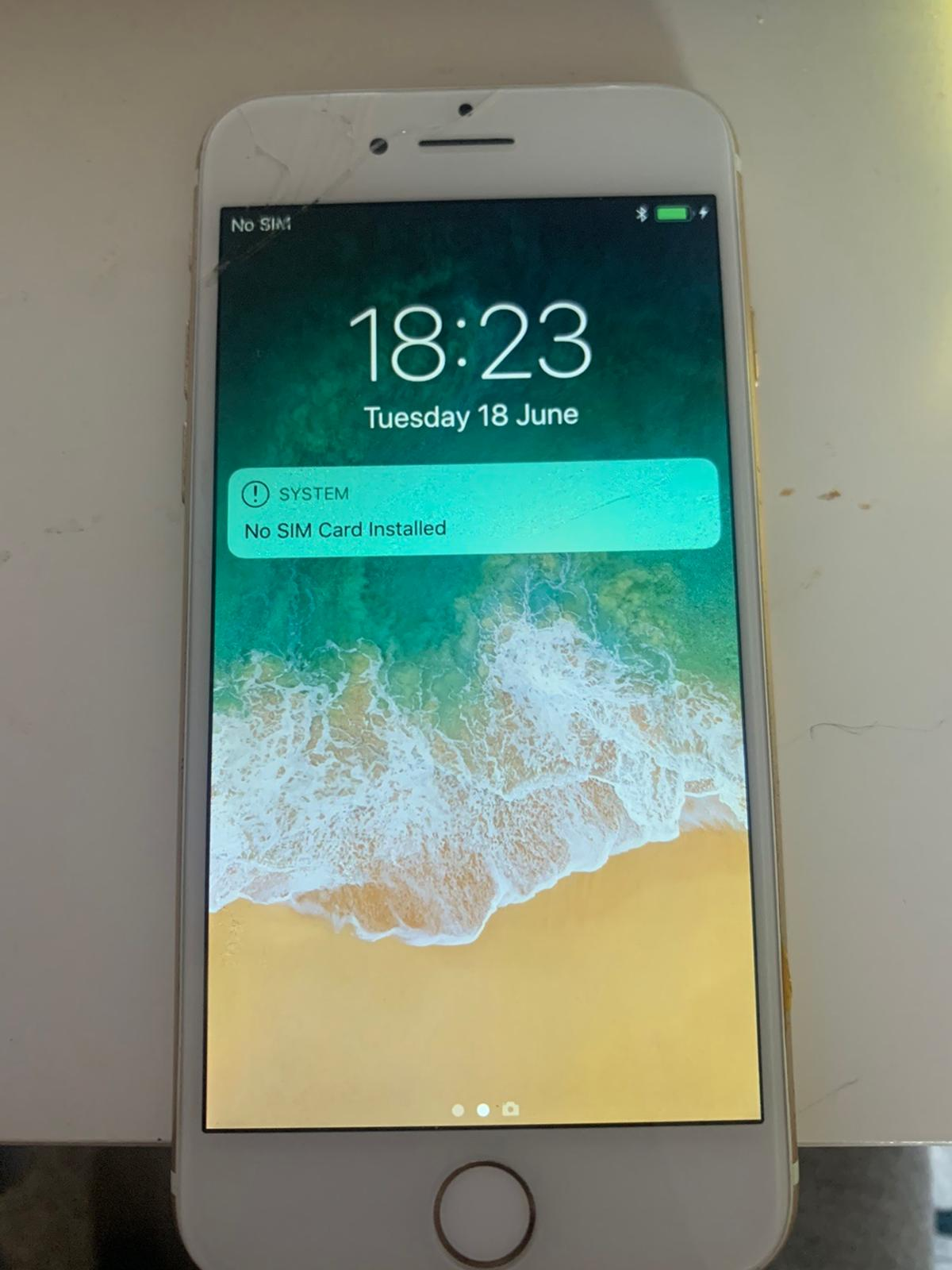 iPhone 7 gold Slight cracks on screen works perfect Scratches on the back and around the edge 128gb  Collection only