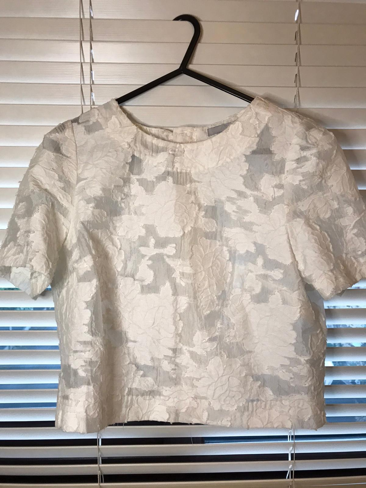- women's h&m white mesh floral top size 10 (would fit size 8) - never been worn selling as it doesn't suit me - originally £25 OPEN TO OFFERS