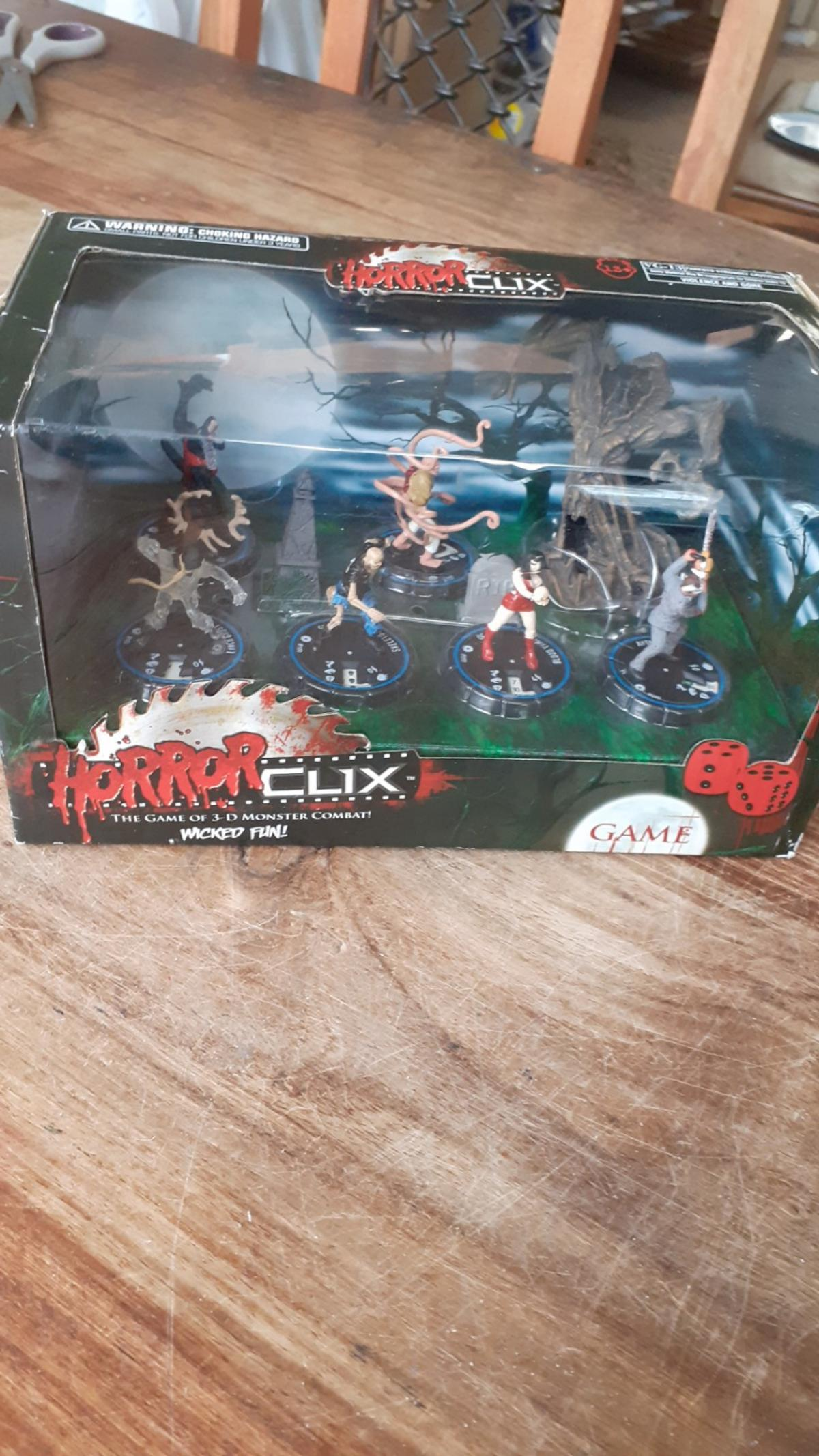 horror clix game of 3d monster combat ,this 1 wicked fun all new and in box with 6 figures and a tree