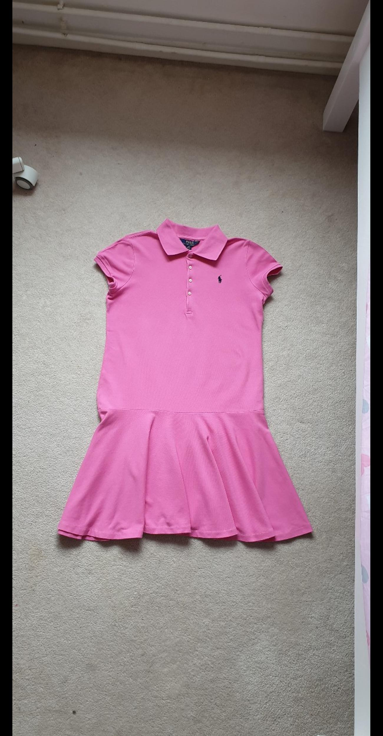Ralph Lauren girl dress age 12-14 years in excellent condition . Used only once or twice . The dress length is 81 cm The measurement from armpit to the other armpit is 44 cm. Please have a look at my other items. Thank you.