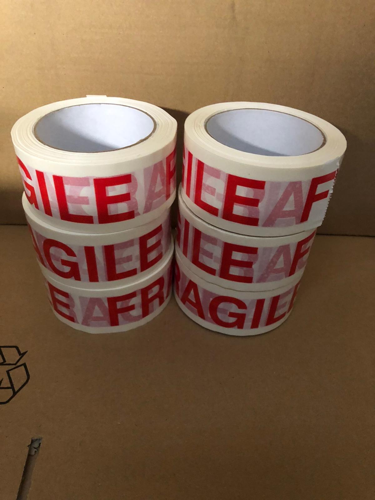 Fragile tape 1 roll £1 6 rolls £5  1 box (36rolls) £25  1 roll = 48mm x 66mt  Can deliver  Message for details