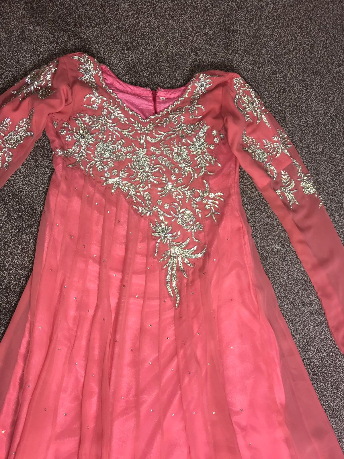 embroidered peach Dress with silver diamonds on the front and the back Also has silver diamonds on the arms Comes with a scarf and trousers Only been worn a few times In great condition Message me for more information