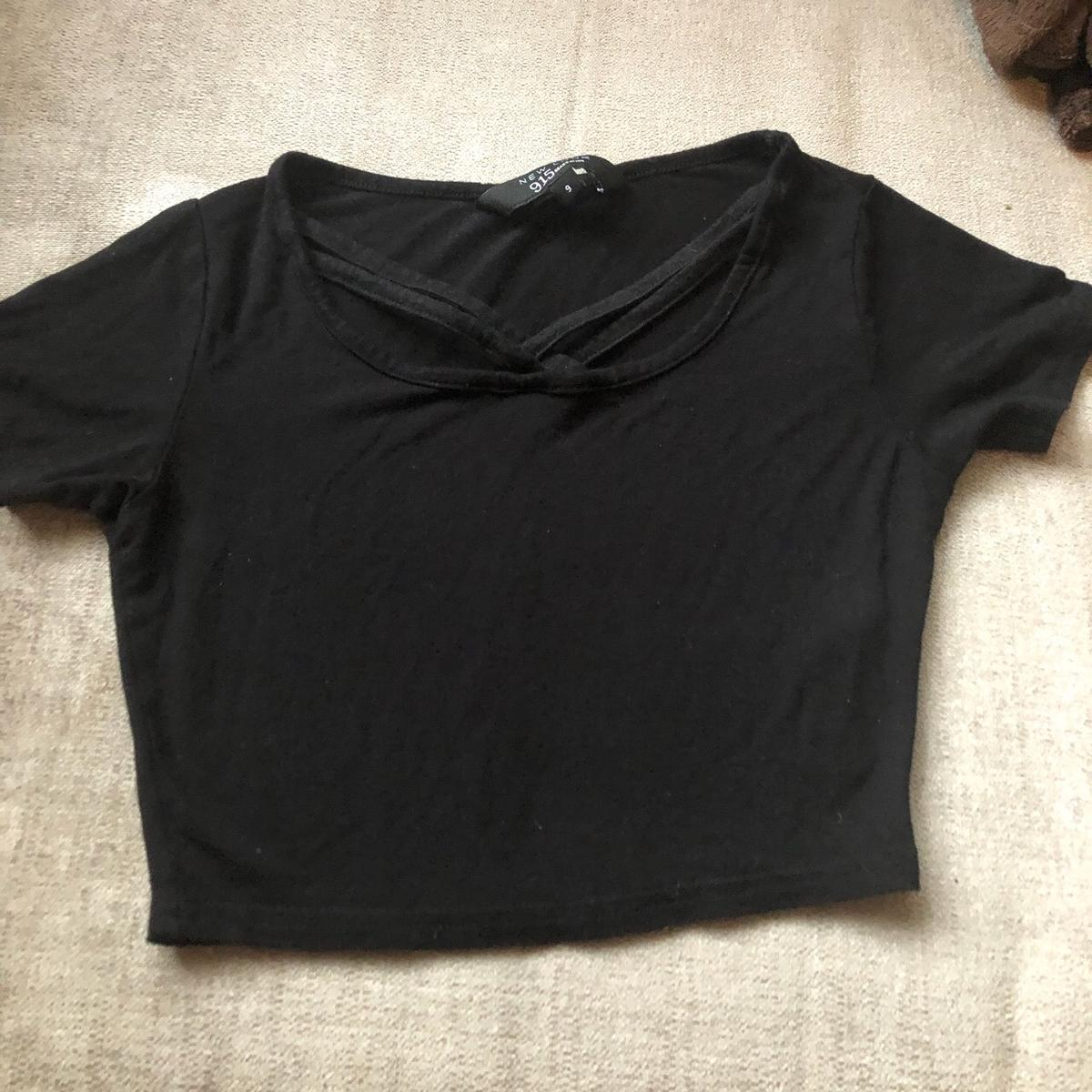 New look girls black crop top Age 9 ( but could for age 10 as stretchy) Good condition Brought for £8 Selling for £5 ( will negotiate price ) Postage £4