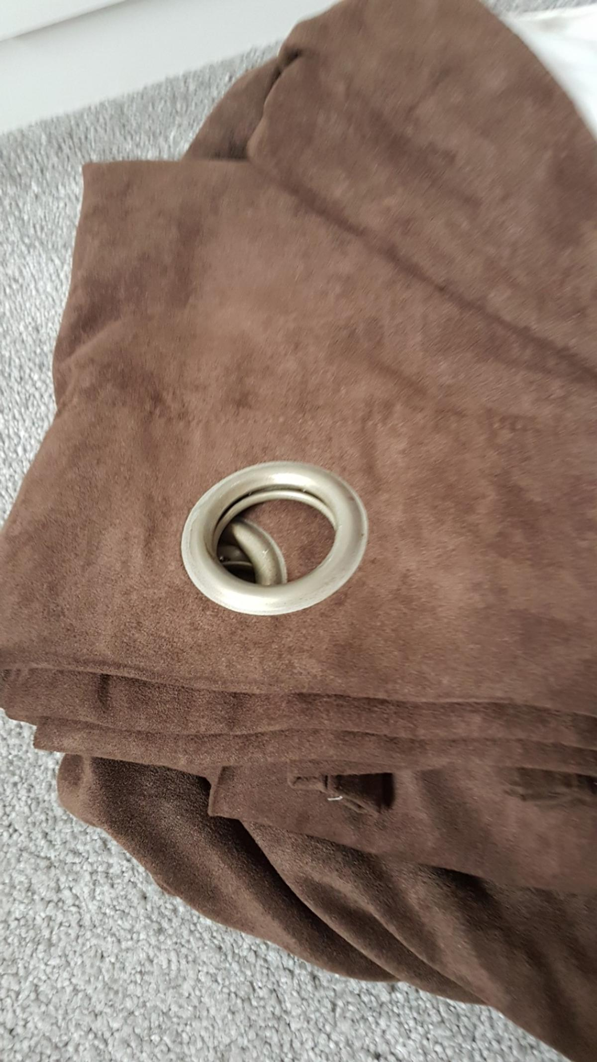 Brown faux curtains for sale. drop is 208cm and the width is 320cm. buyer to collect. smoke and pet free home.