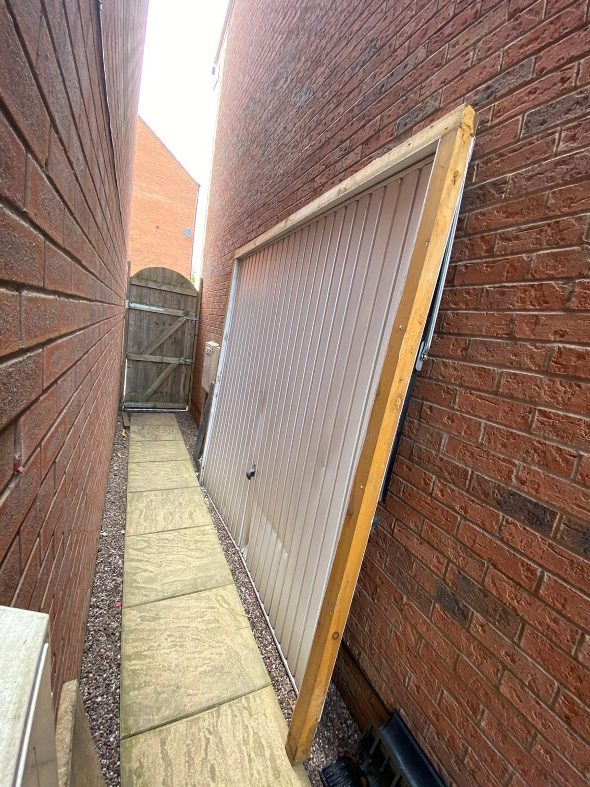 Garage door removed from conversion.  Has some small dents which can be rectified if you know how. Includes wooden frame.  Dimensions Actual door 7ft x 7ft With frame W228cm H221cm  Sold as Seen. Collection only. Cash/Bank transfer on collection.  Located in Walsall WS2