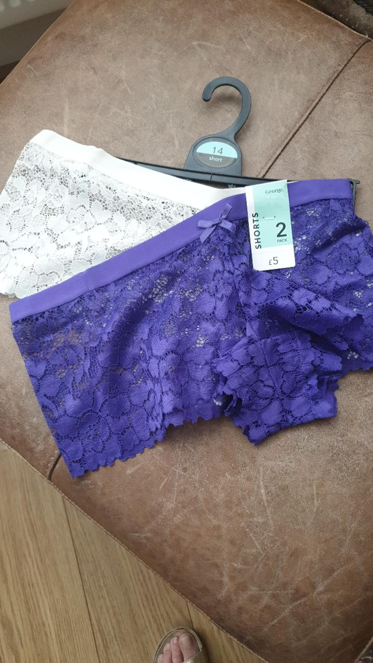 beautiful lace knickers . one purple one cream. wash lovely and keep shape . snug fitting . no offers please. also black and red .