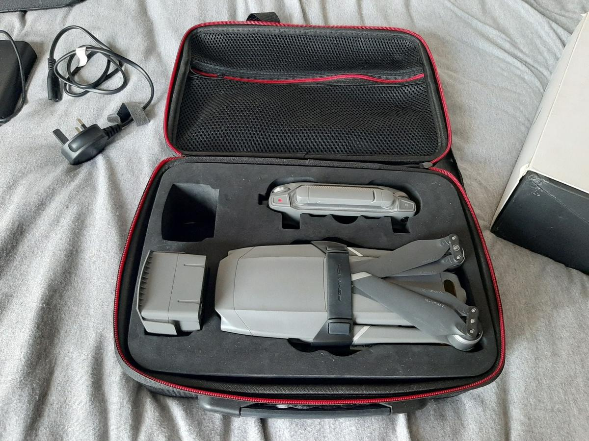 dji mavic 2 zoom all fully working comes with 2 cases one has a bust zip and other has a slight issue with zip on the inside comes with 2 genuine batteries comes with 3 pairs of thump sticks for controller has normal charger also has in car charger has usb battery adaptor few phone cables any questions just ask