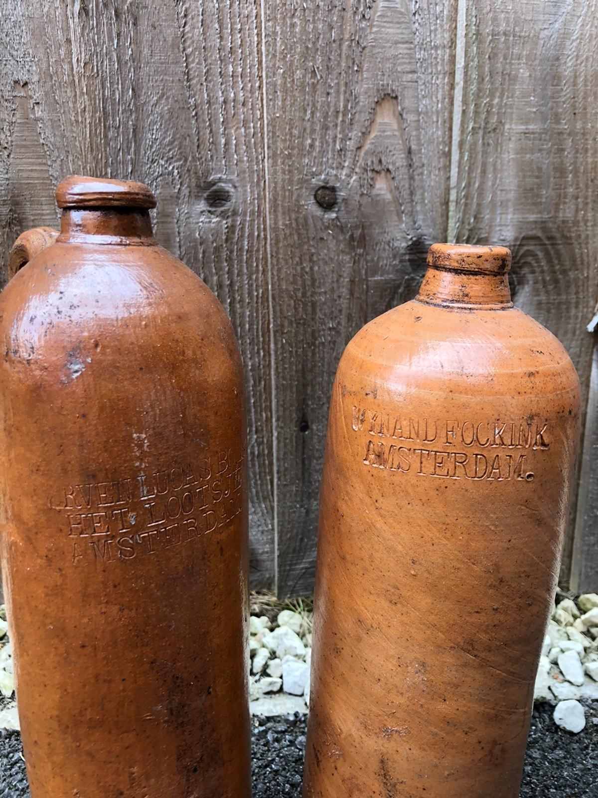 Dutch brewery antique demijohns. Sold as pair. Great antique look. Collection only.