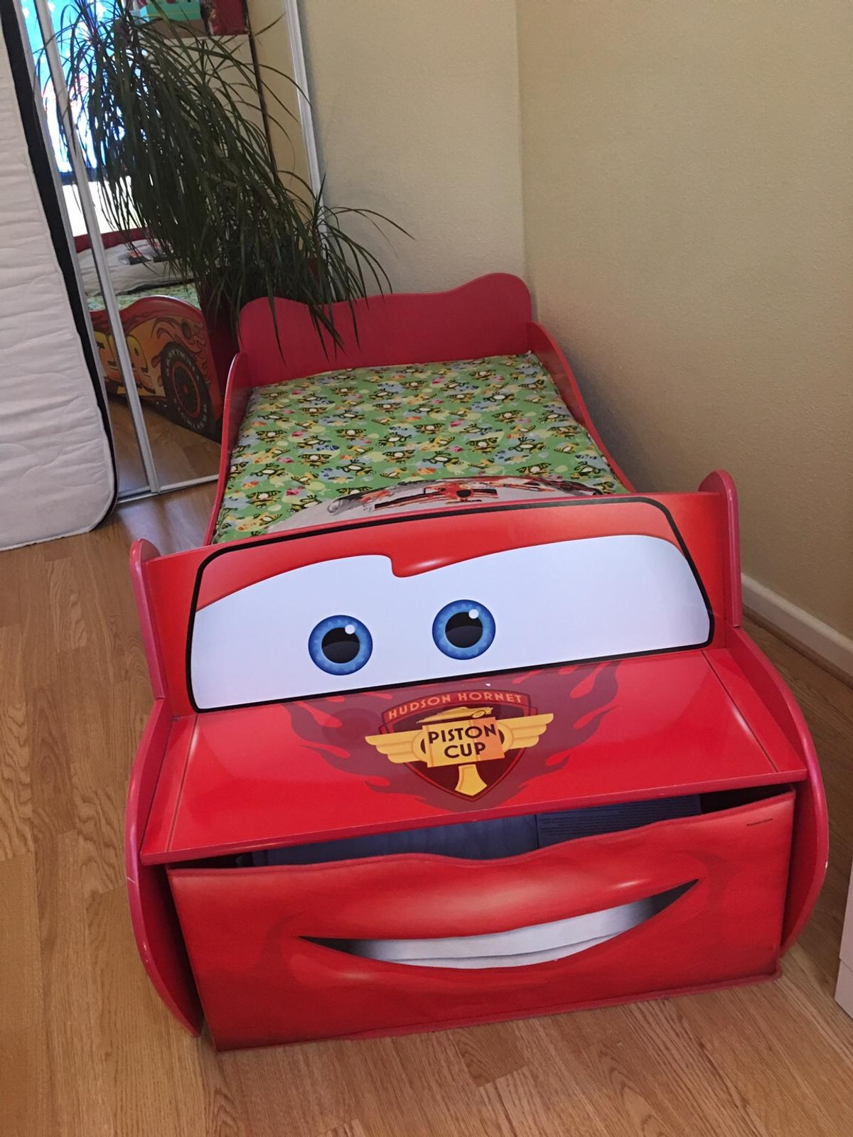 Suitable for up to 5-6 years In a very good condition Approx size: 54.4cm (H) x 76.7cm (W) x 169.5cm (L)  Hardly used, very clean mattress included (mattress size is 140cm (L) x 70cm (W) from Mothercare, washable cover. At front is space for under bed storage Low to the ground and with protective side panels Manual instruction included Can deliver locally