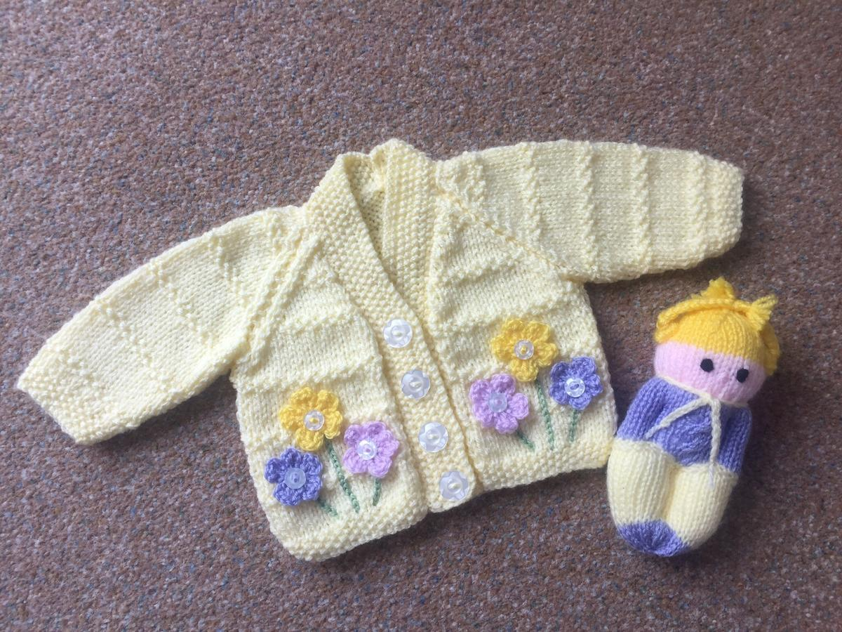 """Very pretty cardigan 0-6 16"""" chest Comes with a free Comfort doll to match £10.00 Pickup syston Leicester Postage £3.00"""