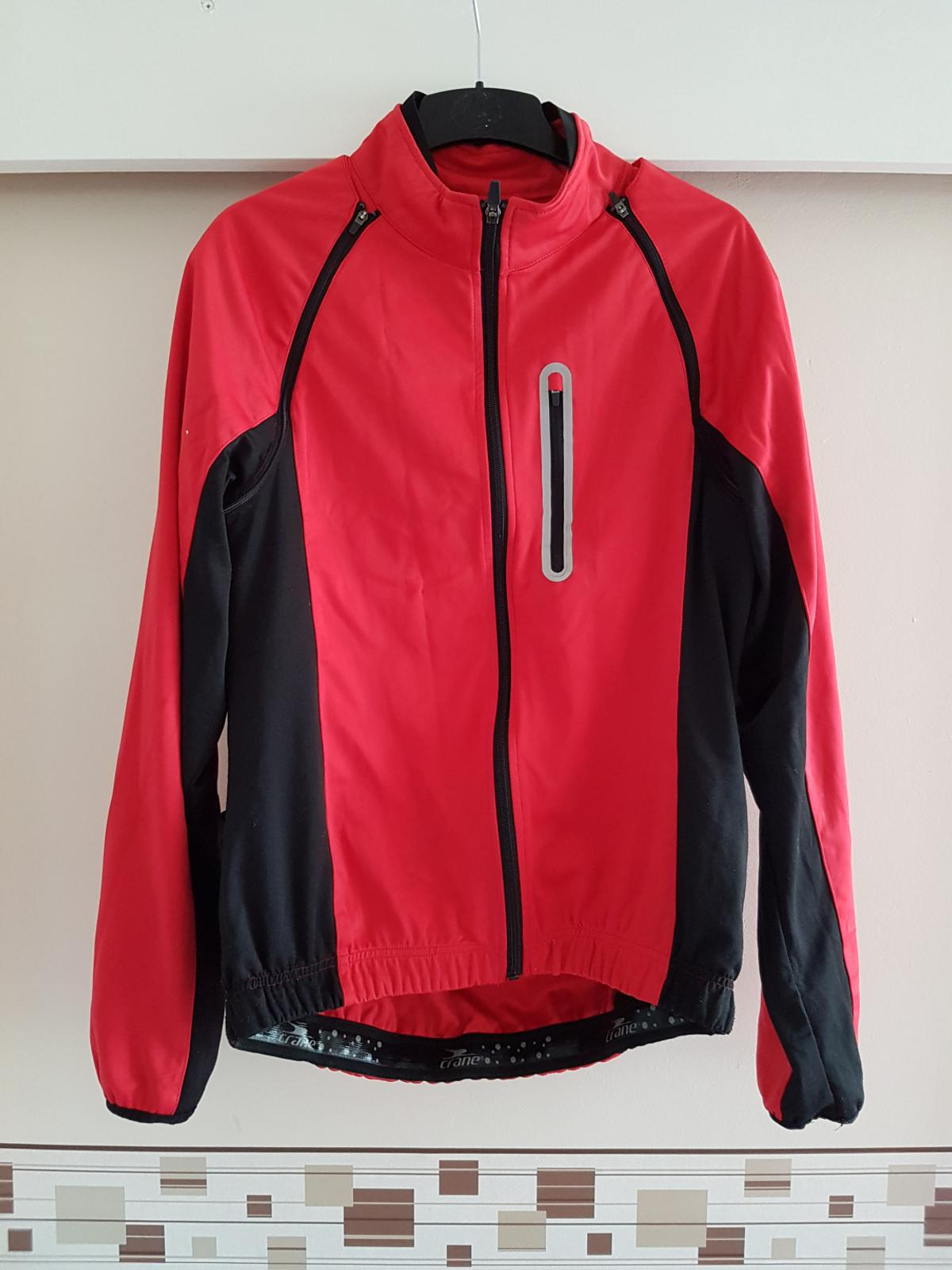 crane cycling jacket with rear pocket and sleeves comes off,excellent condition