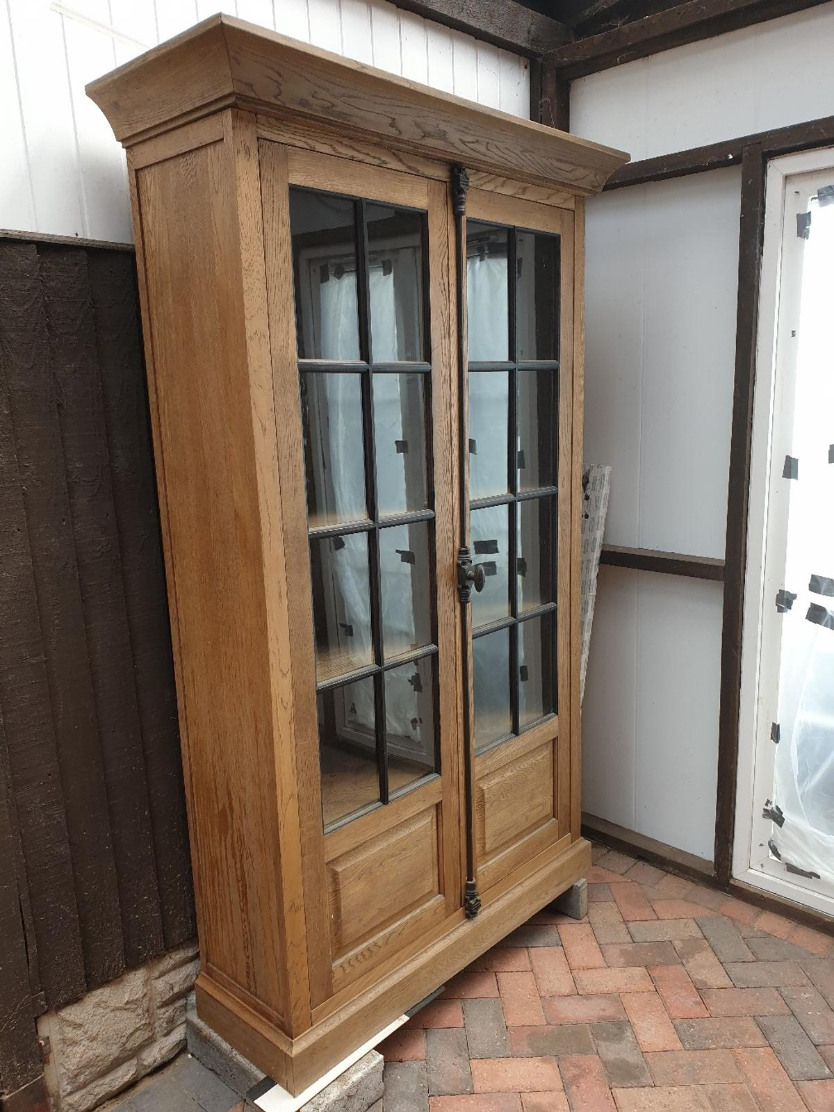 This sold hard wood cabinet is in top condition. A really nice design. Glass and wood doors. Has to be viewed.