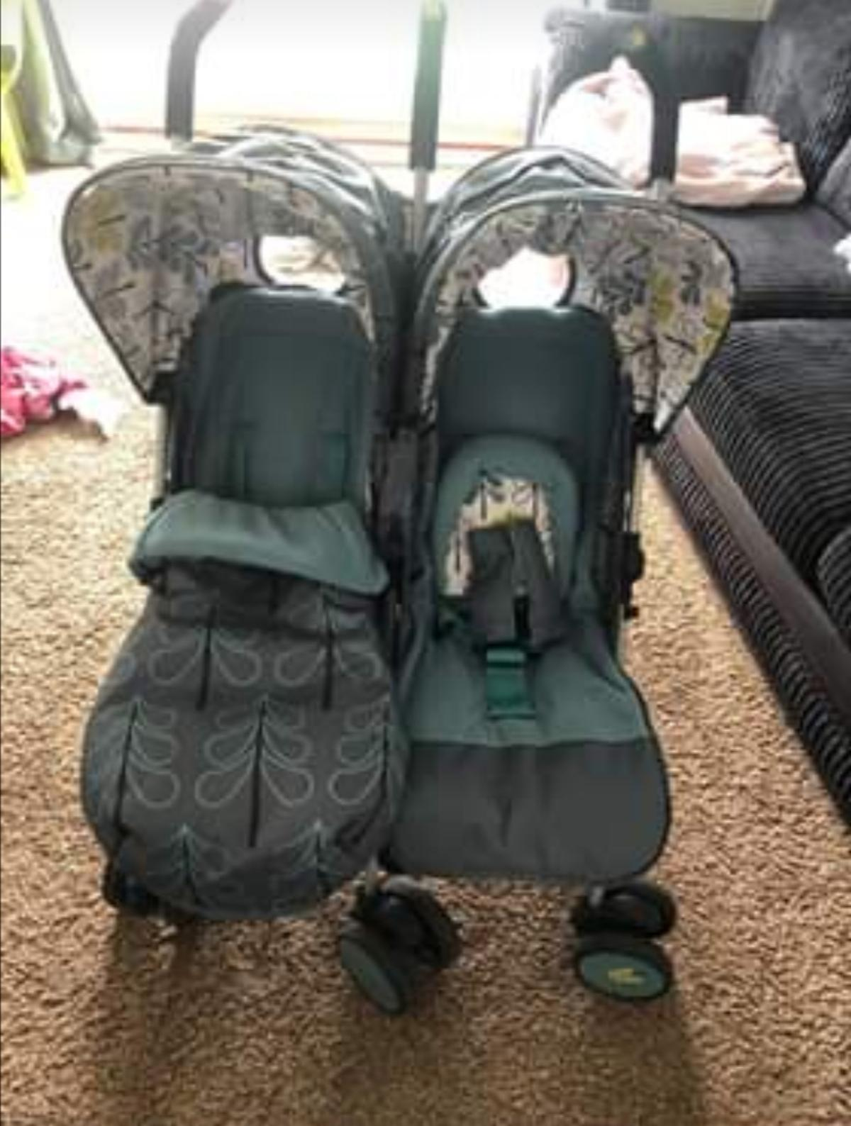 *For sale* Cosatto double pram, only used for about 4 months. In very good clean condition!! Comes with raincover, only issue is that one of the footmuffs lost its zip. So one side has no footmuff. Has pockets in the hood for ipads. COLLECTION ONLY from Ruardean Hill, £100.