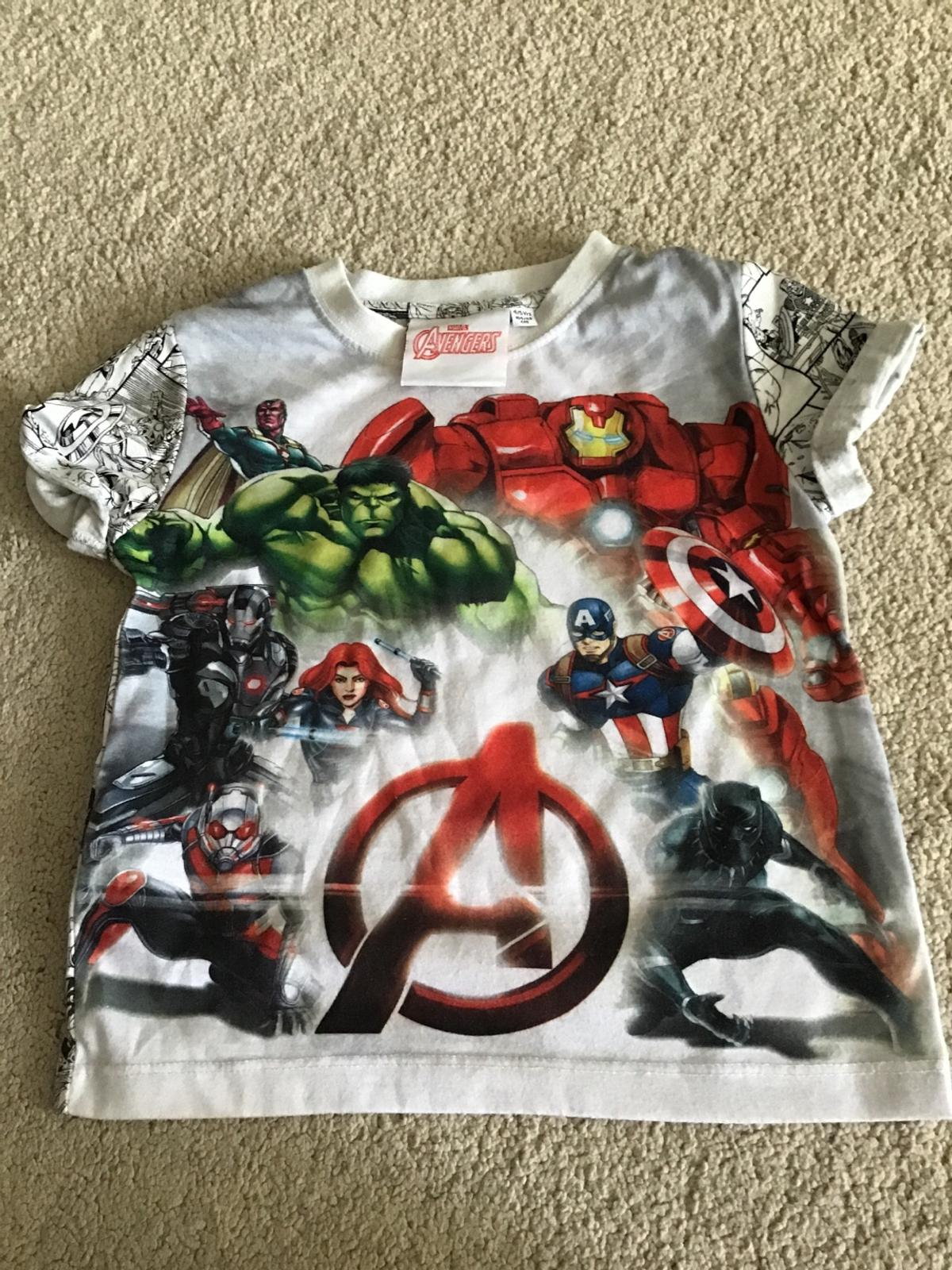 Super heroes on the front of the t-shirt  PAYMENT ONLY BY PAYPAL ONLY METHOD I WILL ACCEPT ITEM TO BE COLLECTED AFTER LOCKDOWN OR CAN BR PAID BY PAYPAL AND LEFT IN A BAG IN MY GARDEN READY FOR COLLECTION