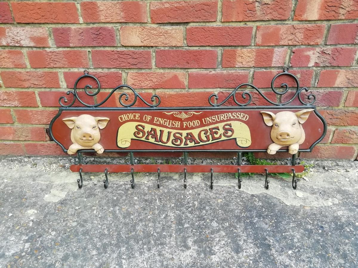 A beautiful antique wall mounted coat hanger. Made from solid iorn featuring two 3D pigs. Absolutely beautiful condition with no restoration required