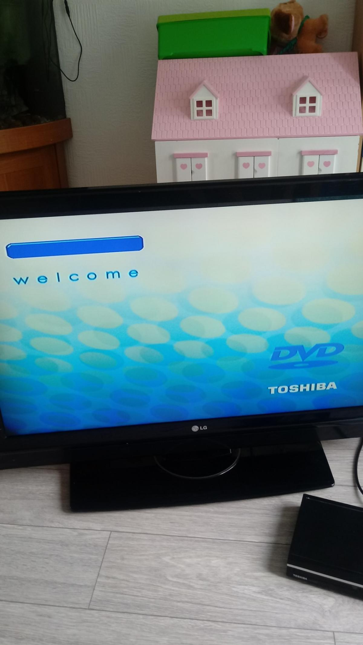 Lg tv 42inch. flickers at start than plays ok look at picture. Sorry no remote. Toshiba dvd door sticks but both work ok spares or repair maybe . No back on remote thanku for looking.