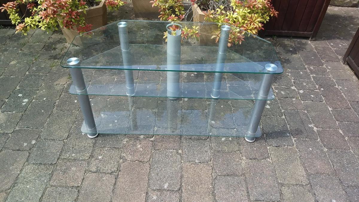 Tv Unit clear glass with silver legs  Used in good condition has some marks to the top can't be seen when TV in place  Measures Length 100cms Height 52cms Depth 46cms 2 shelves bottom shelf 27cms gap centre shelf 15cms gap  Cash on collection £12 no offers Thanks  Collection from S75 Dodworth Barnsley 2 mins from J37 M1  Thanks for looking