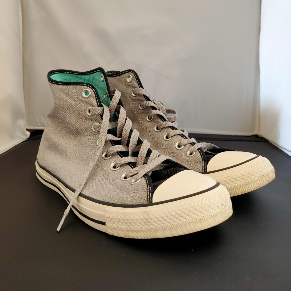 Grey and black Converse trainers. Used but in very good condition.