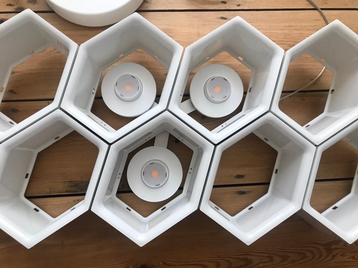 Philips honeycomb LED hanging light RRP £600. It is an ex display item and needs rewiring. Please refer to the photos as the main part of description. It is also missing strings to attach the light to the ceiling but this can easily be rectified. 67 x 29 cm