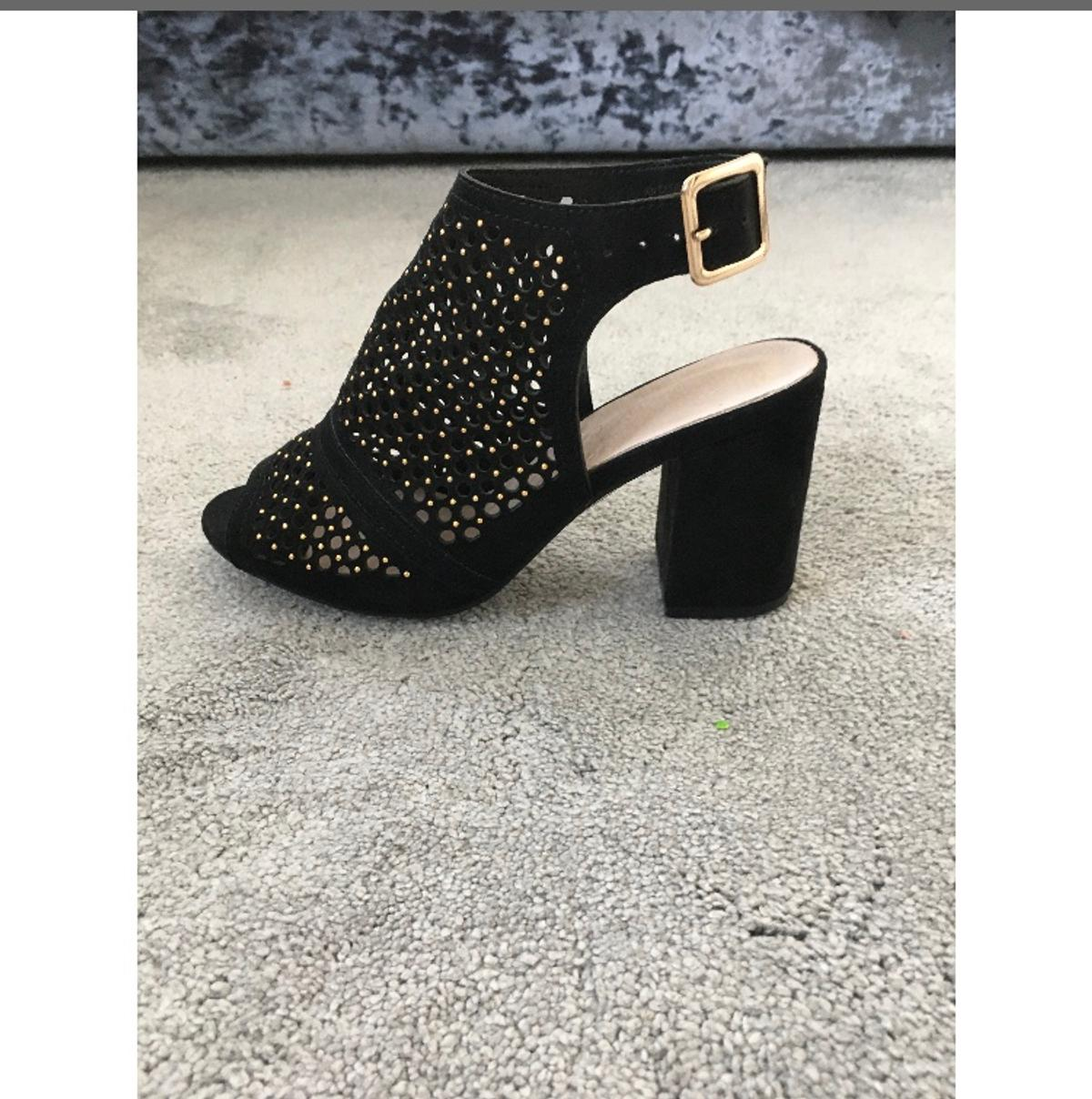 Black and gold heeled sandals. Open toe and open heel. Worn once. Size 3.