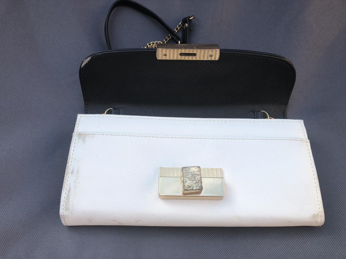 Women's clutch bag This bag has never been used, although sadly due to storage, on the outside, it has some stain marks and scratches as shown on pictures. Inside is spotless and clean.  It was purchased at £25.