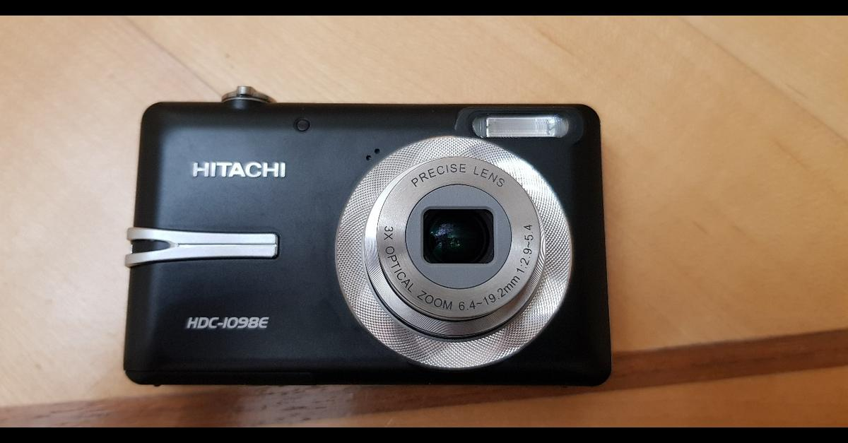 Hitachi 10MP compact digital zoom camera for sale, 3x zoom, rechargeable battery, charger, case, software, manual, box, case. Exc condition