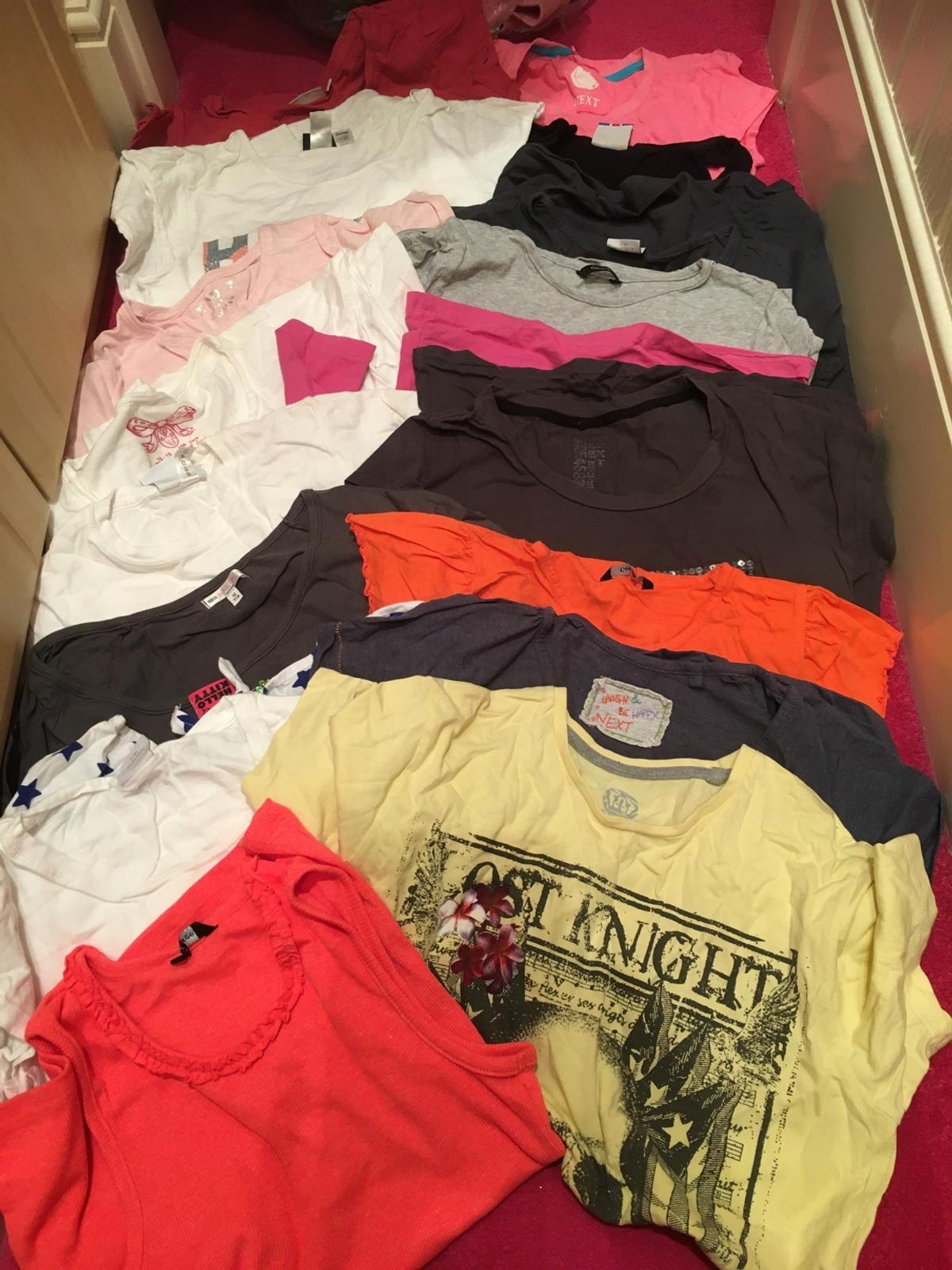 Large bundle of girls different designs of tops mainly from next with glitter sparkles and die Montes age 12 hardly worn from a clean and smoke free home £1 each or the whole bundle for £13