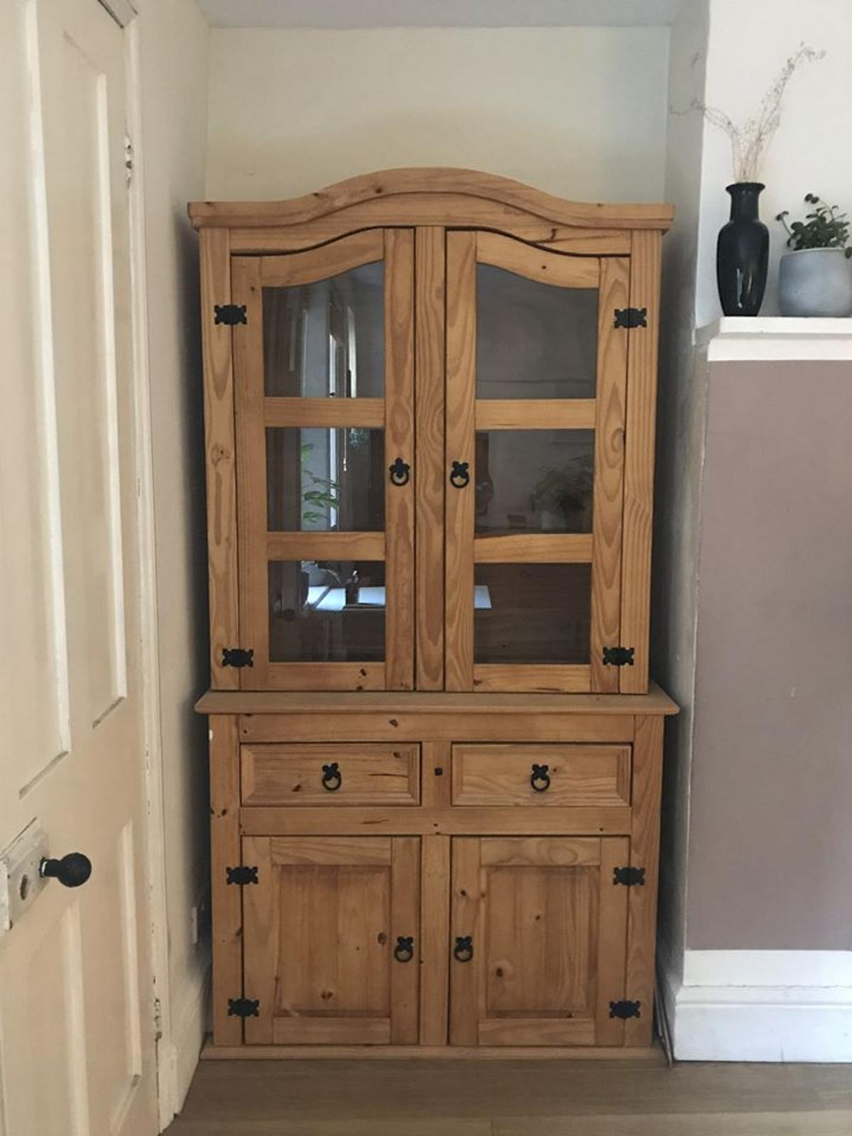 2 Solid Pinewood Dressers in very good condition.  The top display unit can be separated from the lower cupboard unit which will make it easier for transporting.  Measurements: 1060mm width 1980mm height 470mm depth lower unit 335mm depth upper unit  For collection only.