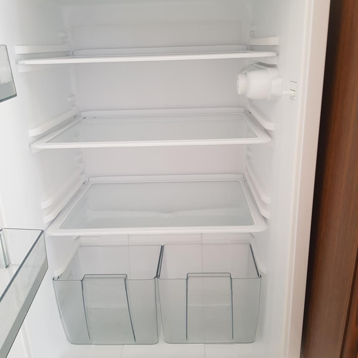 white integrated fridge  5 years old good condition except a very slight split in the seal on the top outer corner but hasnt affected use.  measures; w 550mm d 550mm h 870mm  collection, or local delivery to lordswood can be arranged following the safe distancing rules