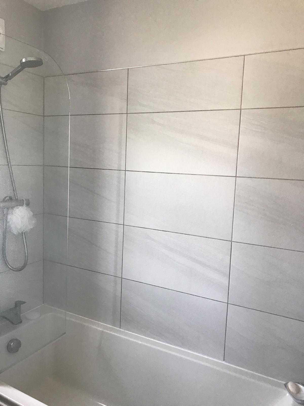 Large white tiles with slight grey shadow, almost two boxes, 13 tiles in total, suitable for small area, Couldn't return to shop as lost receipt