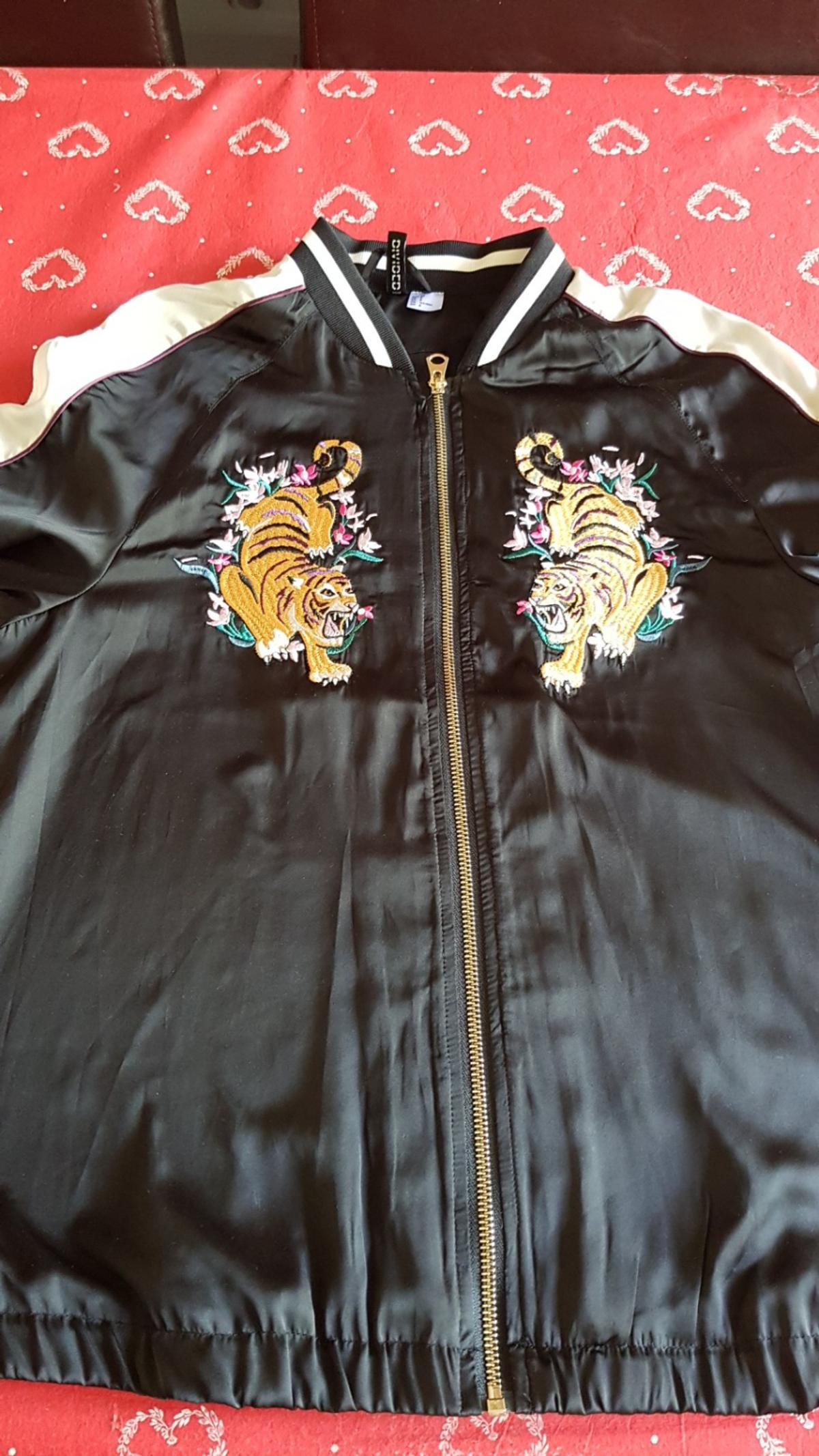black with design brand new jacket size 12