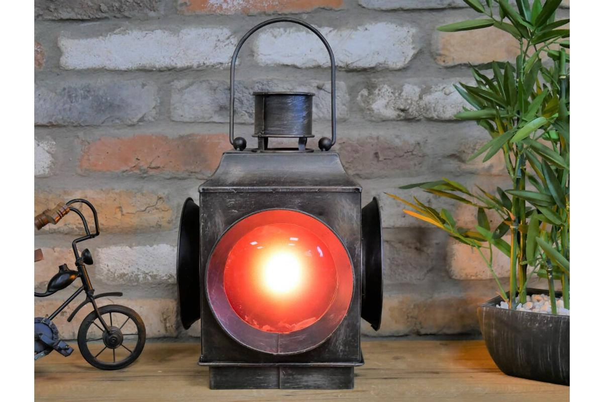 Authentic looking lamp works with batteries. Industrial metal Railway Light Lamp Lantern.  Metal lamp battery operated  H: 42cm W: 23cm D: 23cm  Weight: 2.19kgs  Very authentic looking I have used mine outside but I will take indoors in the winter. Delivery is available £6.99