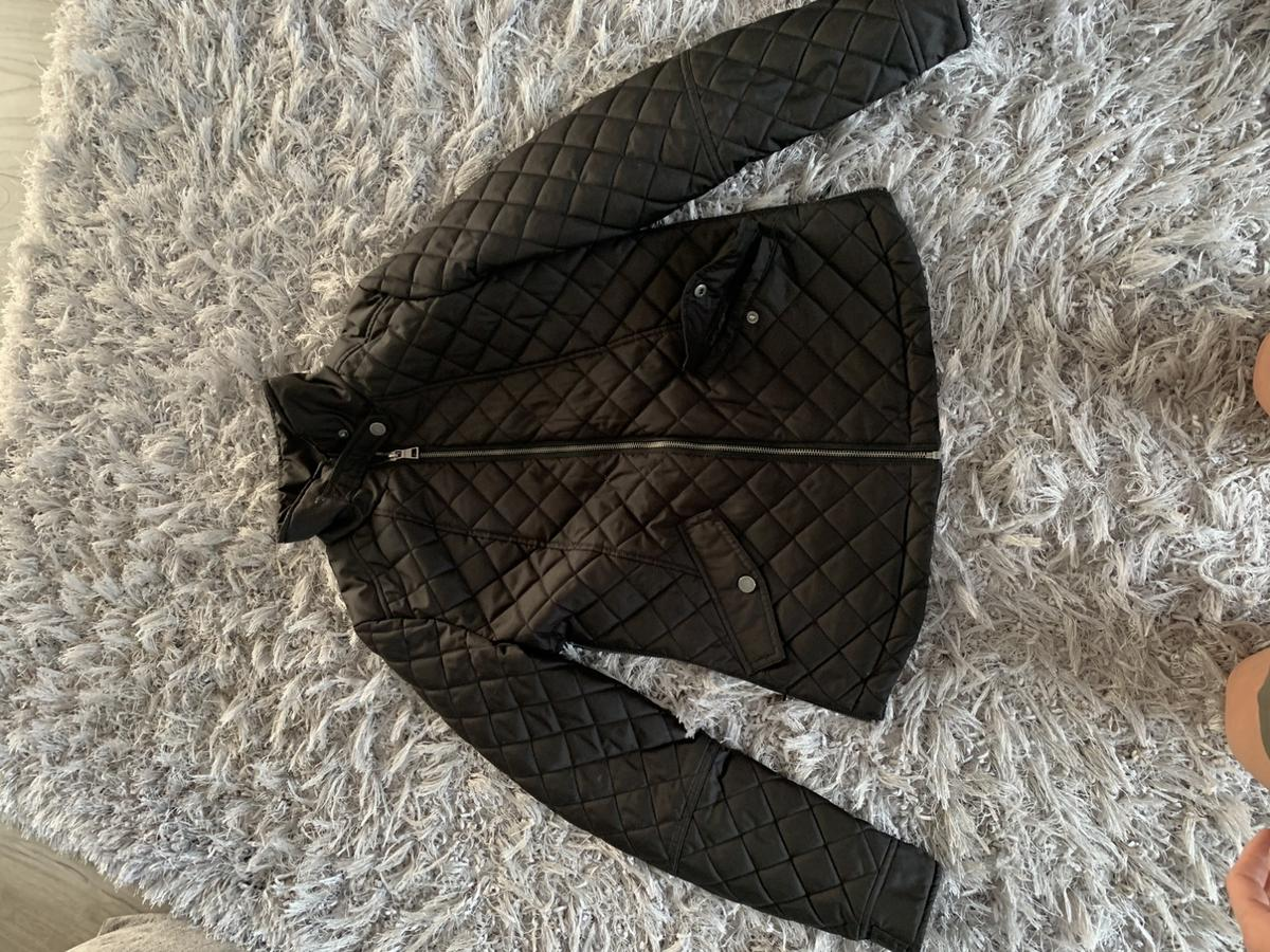 Ladies black quilt effect jacket.  Used but good condition.  Two poppered pockets. Zips on side to allow movement over hips. Shower resistant.  Pick up Whitley wood, Reading.