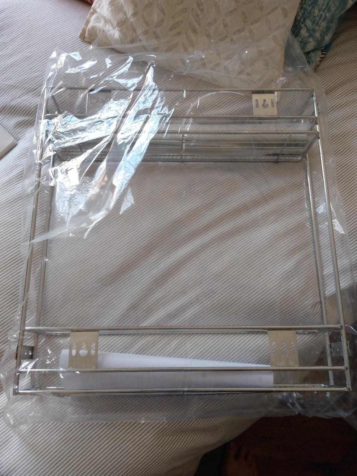 Brand new still in box as I have two but now only need one set for my new kitchen.  Ball bearing runners for smooth & quiet operation  Manufactured from steel with 2 x wire trays  Ideal storage for bottles  Maximum weight: 10kg  Minimum cabinet depth: 470mm  Minimum cabinet width: 115mm  Pick up only and cash only please.