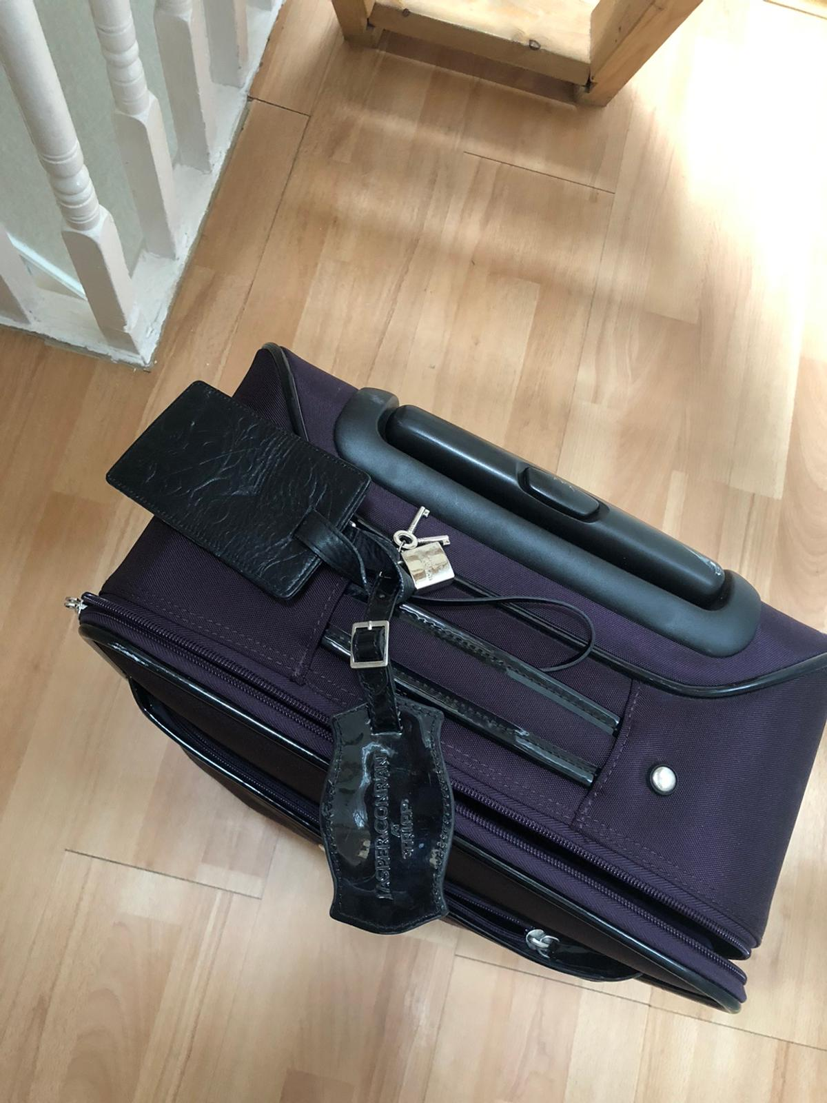 Beautiful and trendy deep purple colour cabin size suitcase In great condition Well looked after Collection from Walthamstow
