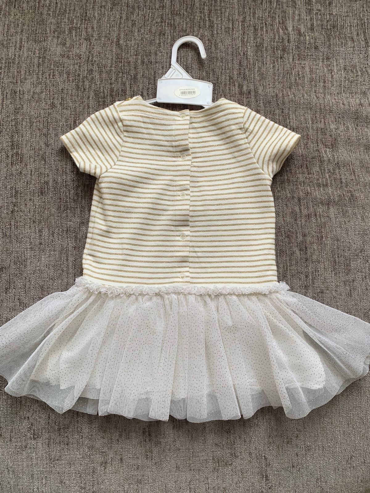 Beautiful gold stipe top and gold glitter skirt girls dress in immaculate condition form luxury brand Petit Bateau From pet free smoke free home Size: 18M or 81cm