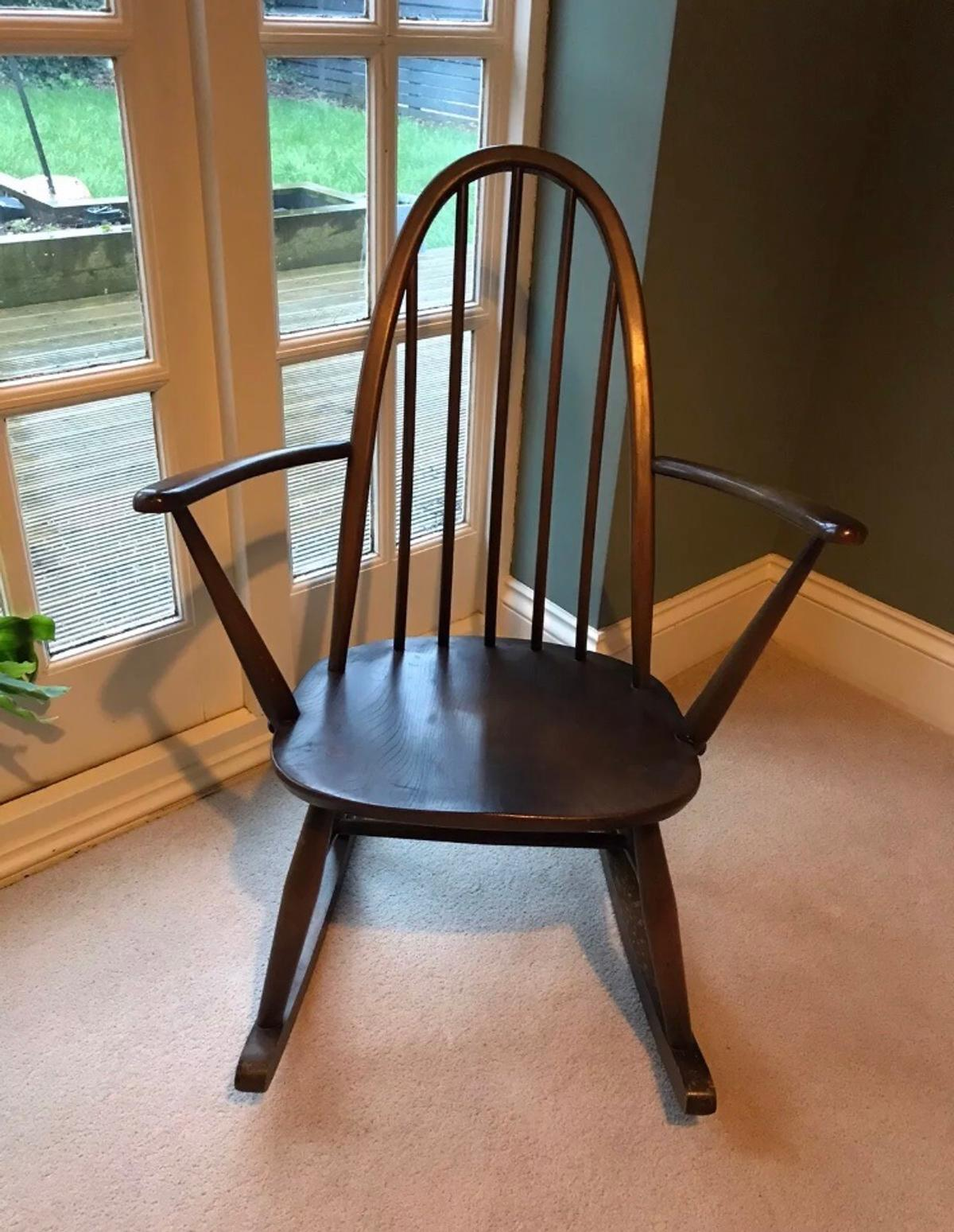 Beautiful Ercol Rocking Chair.  Comes with its original cushion  1960.  Model 2056.  Good condition although usual signs of wear due to its age as shown in the photos  Please note it's dimensions:  85cm high (floor to top of back)  62cm wide (from arm to arm)  71cm long (from front to back/rocking legs)  Many thanks